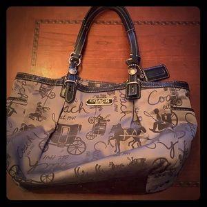 Grey satin coach purse